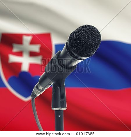 Microphone On Stand With National Flag On Background - Slovakia