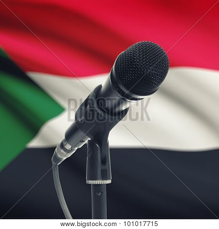Microphone On Stand With National Flag On Background - Sudan