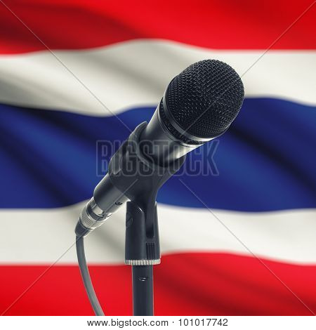 Microphone On Stand With National Flag On Background - Thailand