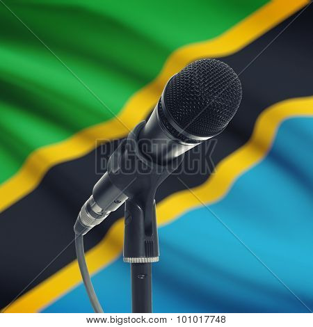 Microphone On Stand With National Flag On Background - Tanzania