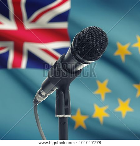 Microphone On Stand With National Flag On Background - Tuvalu
