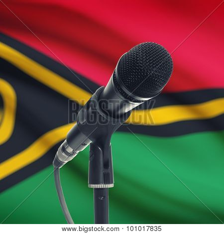 Microphone On Stand With National Flag On Background - Vanuatu