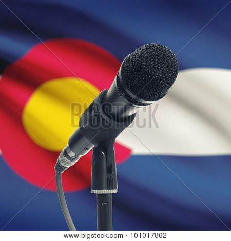 Microphone On Stand With Us State Flag On Background - Colorado