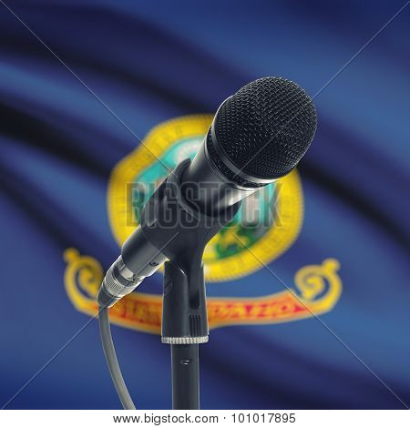 Microphone On Stand With Us State Flag On Background - Idaho