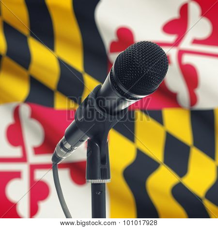 Microphone On Stand With Us State Flag On Background - Maryland