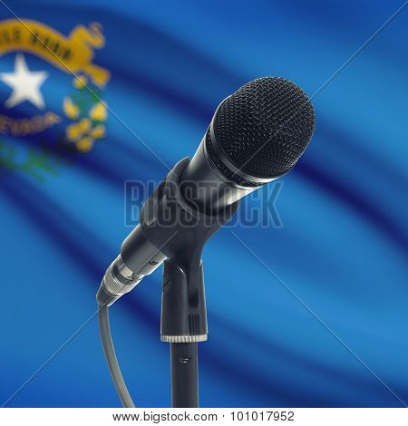 Microphone On Stand With Us State Flag On Background - Nevada