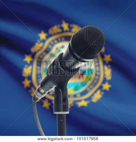 Microphone On Stand With Us State Flag On Background - New Hampshire