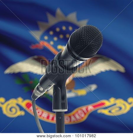 Microphone On Stand With Us State Flag On Background - North Dakota