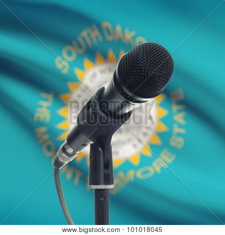 Microphone On Stand With Us State Flag On Background - South Dakota