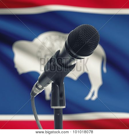 Microphone On Stand With Us State Flag On Background - Wyoming