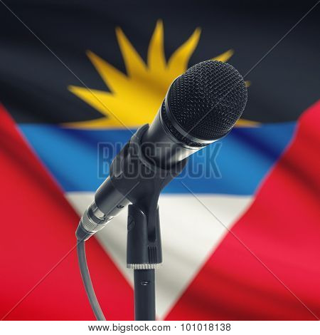Microphone On Stand With National Flag On Background - Antigua And Barbuda