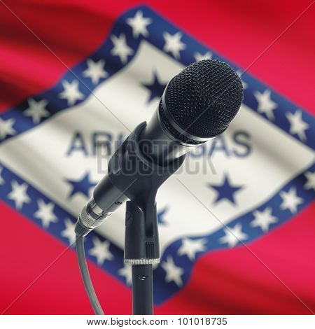 Microphone On Stand With Us State Flag On Background - Arkansas