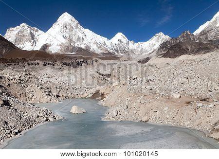 View Of Khumbu Glacier With Lake And Pumori Peak