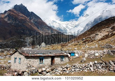 Nepalese Building In Langtang Valley And Langtang Peak