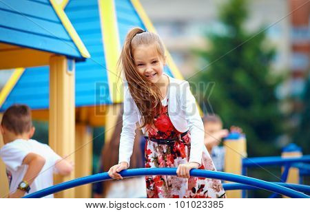 Happy Young Girl Playing On Outdoor Playground