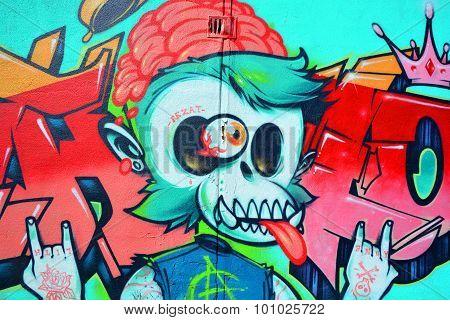 Street art Montreal dead monkey.