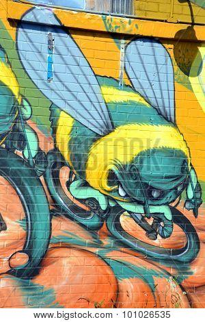 Street art Montreal bee on bike.
