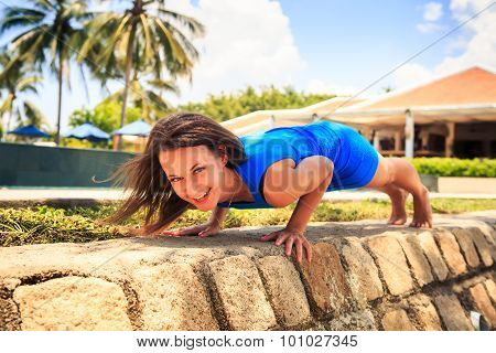 Slim Girl In Short Blue Pushes Up On Barrier Near Pool