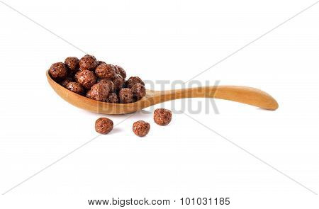 Cereal Chocolate Balls In Wooden Spoon On White Background