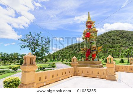 Ancient Statue Of Giant Guardian At Public Park With Mountain Background.
