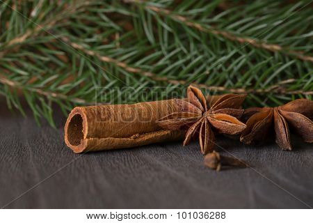Star Anise And Fir  On Background A Wooden Boards
