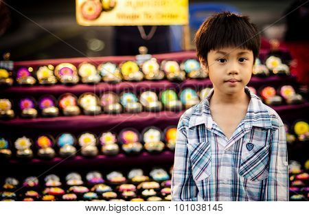 Portrait of asia boy looking at camera