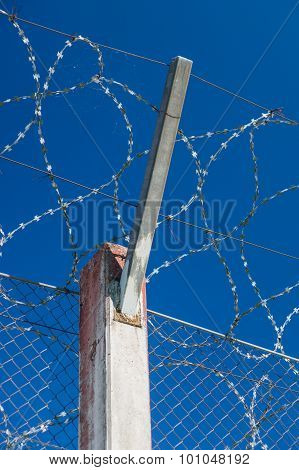 Prison Concrete Pillar And Barbed Wire Fence