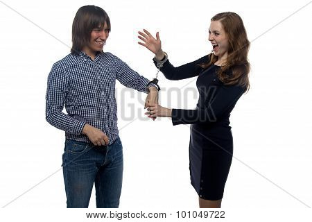Man and gloating young woman with handcuffs