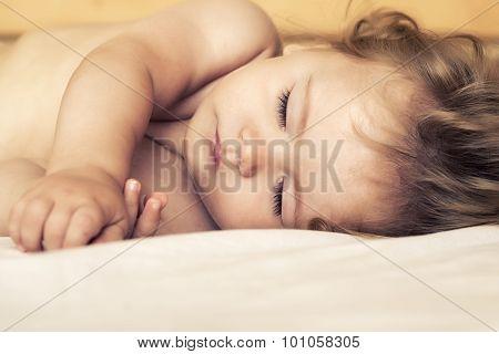 Sleeping Baby In Bed