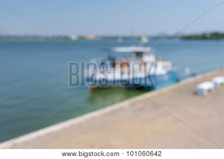 Blurry natural background - summer landscape with river Dnepr and pleasure boat