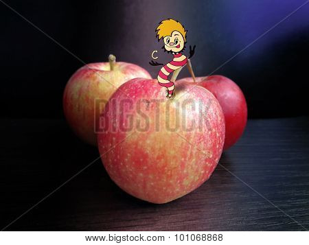 Combination of drawing and photography - a worm crawled out of the apple