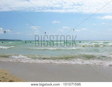 Kitesurfers hit the waves