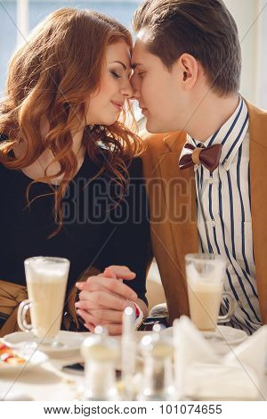 A couple in love in a summer cafe