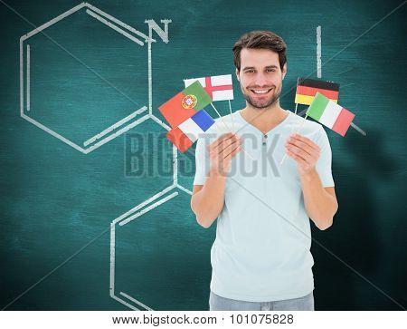International student against green chalkboard