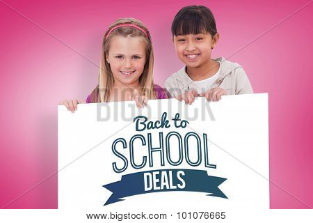 Girls behind a blank panel against pink vignette