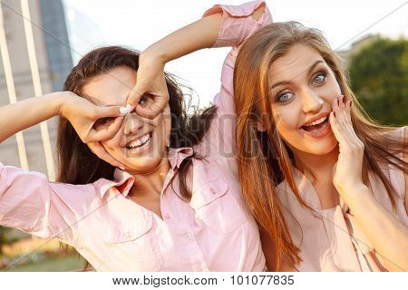Two cheerful girls fooling around