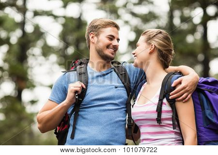 Young happy hikers looking at each other in the nature