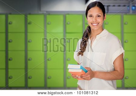 Happy student against locker room