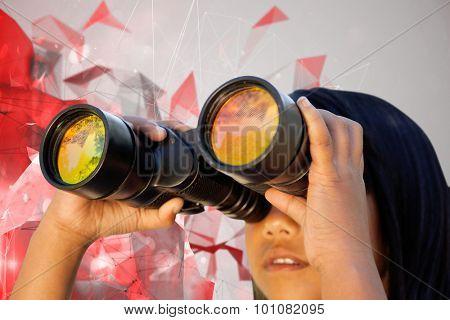 Cute little girl looking through binoculars against angular design