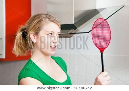 Woman with a fly swat