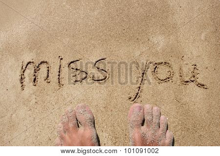 Concept or conceptual miss you handwritten in sand for natural, symbol,tourism or conceptual designs with feet