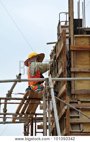 A construction worker fabricating column formwork