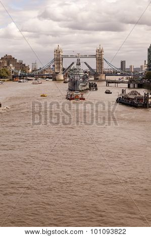 Hms Belfast Moored At Tower Bridge In The Thames