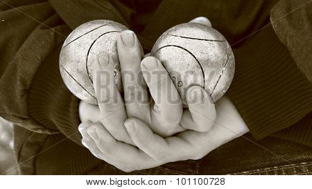 Man holding two boules balls in hands
