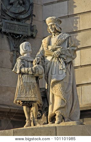 Statues At The Bottom Of The Monument To Christopher Columbus In Barcelona, Spain