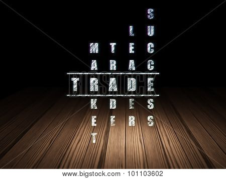 Finance concept: word Trade in solving Crossword Puzzle