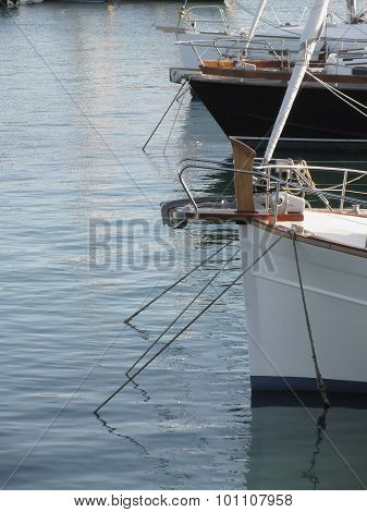 Prows Of Luxury Sailboats Moored In The Harbor In Marina Di Pisa, Tuscany, Italy