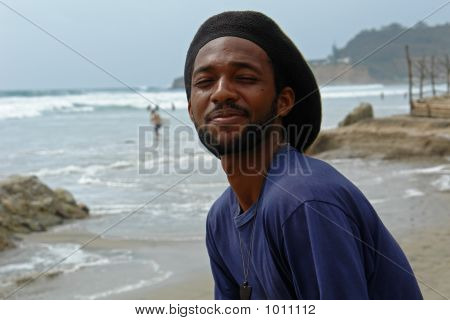 Happy Rasta-Man On The Beach Of Pacific Ocean