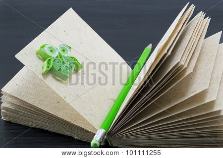 Recycled Paper Notebook With A Green Pen And Green Paper Owl
