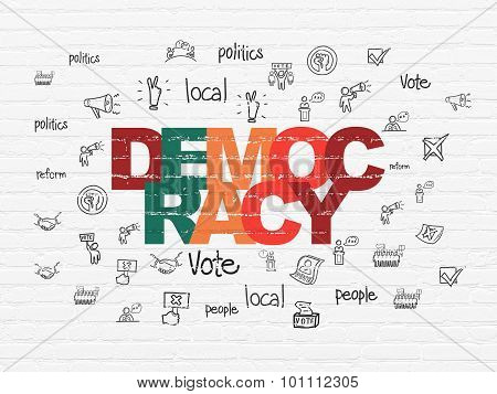 Political concept: Democracy on wall background